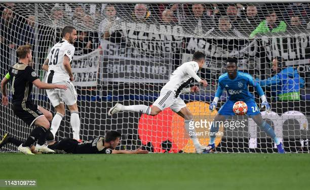 Christiano Ronaldo of Juventus scores the first goal during the UEFA Champions League Quarter Final second leg match between Juventus and Ajax at...