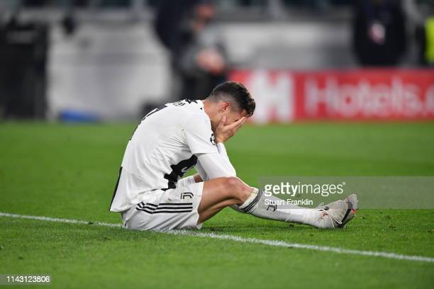 Christiano Ronaldo of Juventus sits with his head in the hands during the UEFA Champions League Quarter Final second leg match between Juventus and...