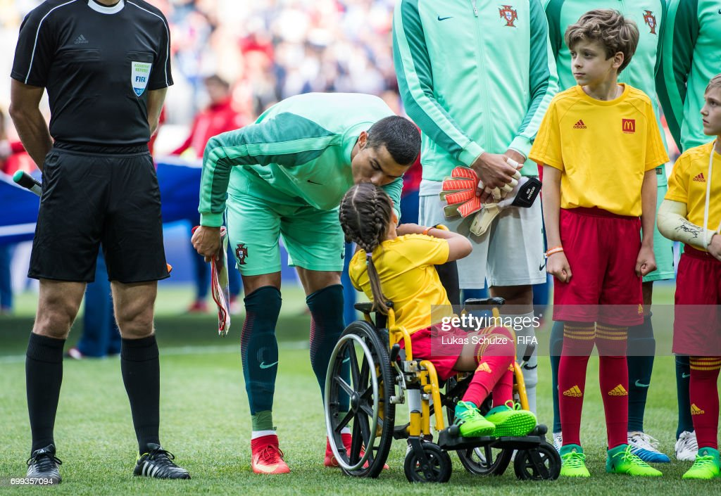 Christiano Ronaldo of Portuga kisses a McDonalds mascot girl in a wheel chair prior to the FIFA Confederations Cup Russia 2017 Group A match between Russia and Portugal at Spartak Stadium on June 21, 2017 in Moscow, Russia.
