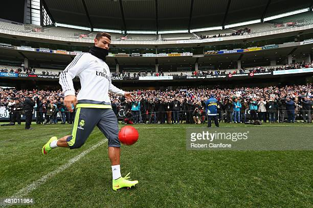 Christiano Ronaldo of Real Madrid kicks an Aussie Rules football during a Real Madrid training session at Melbourne Cricket Ground on July 17 2015 in...