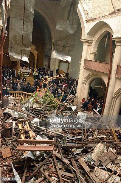 Christians attend a Christmas mass at the Saint Elias Catholic cathedral in Aleppo's Old City which was heavily damaged during the fiveyear war in...
