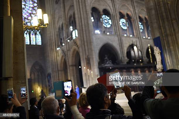 Christians attend a mass for the feast of the Assumption on August 15 2015 at NotreDame de Paris Cathedral in Paris For believers Assumption...