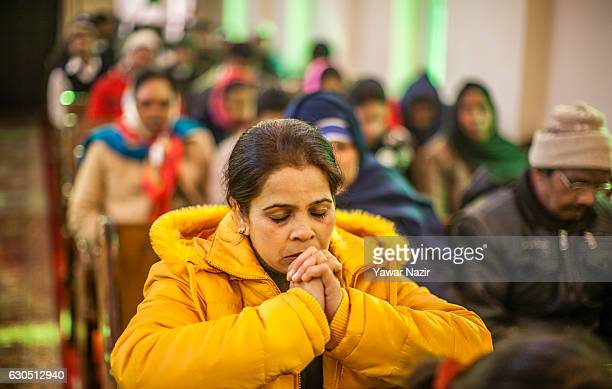 Christians attend Christmas mass inside the Holy Family Catholic Church during Christmas on December 25 2016 in Srinagar the summer capital of Indian...