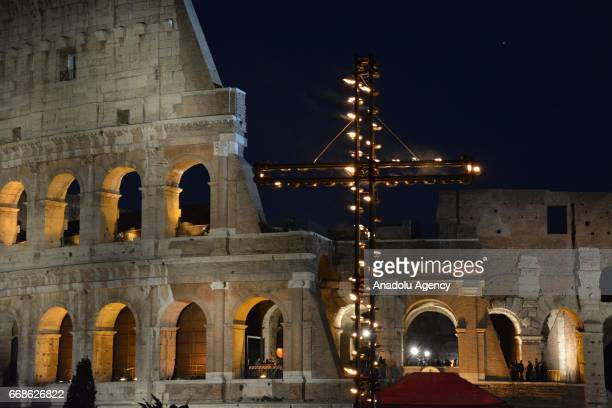 Christians attend the Via Crucis torchlight procession in front of the Colosseum on Good Friday on April 14 2017 in Rome Italy Christians around the...