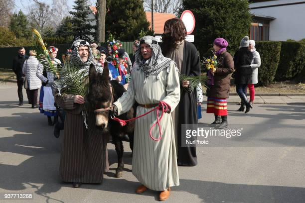 Christians attending the Palm Sunday procession are seen in Pelplin Poland on 25 March 2018 Palm Sunday or Blessing of the Palms falls on the last...