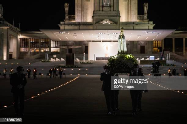 Christians carry an image of Our Lady of Fatima to the altar during the candle procession Prayers of the rosary at the Chapel of the Apparitions in...