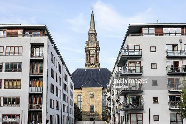Christian's Church between modern apartment building, Copenhagen, Denmark