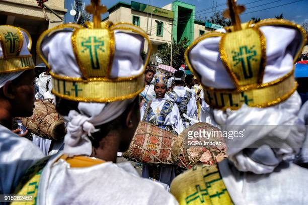 Christians in the traditional white shrouds play the drums during the procession through the streets of Gondar The annual Timkat festival an Orthodox...