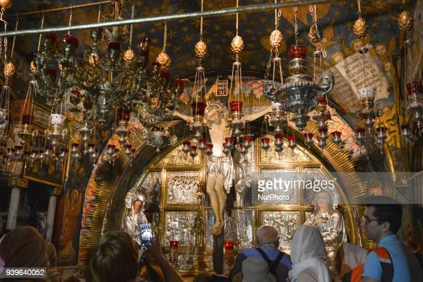 Christians of different denominations pray at the site of Golgotha inside the Holy Sepulchre church in the Old Town of Jerusalem Wednesday 14 March...