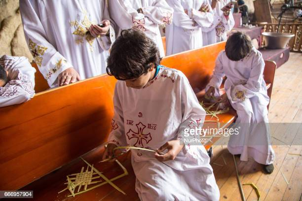 Christians pray during Palm Sunday mass inside the Cave Cathedral or St Sama'ans Church on the Mokattam hills overlooking Cairo Egypt on 9 April 2017