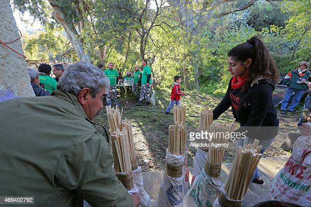 Christians prepare homemade rockets to ignite at 'Rocket War' during Greek Orthodox Easter celebrations in the town of Vrontados on the Greek island...