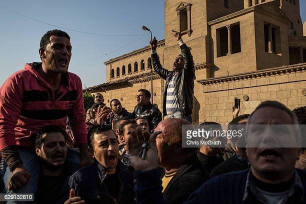 Christians rally in the street outside the church of St Peter and St Paul in the Coptic Cathedral complex on December 11 2016 in Cairo Egypt At least...