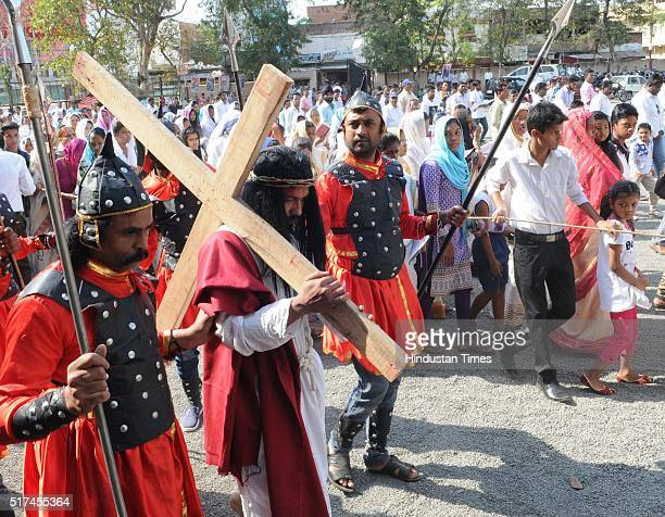 Christians reenacting the crucifixion of Jesus Christ on Good Friday at St Francis Cathedral to observe Good Friday on March 25 2016 in Bhopal India...