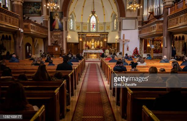 Christians sit apart socially distanced during an Easter Sunday service at Christ the King church on April 4, 2021 in the Balham area of London,...