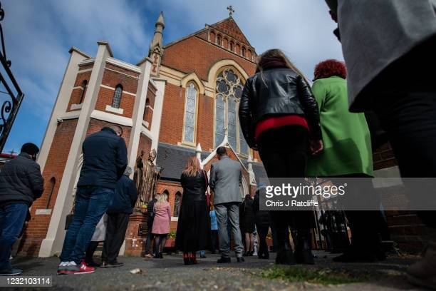 Christians stand outside during an Easter Sunday service due to lack of space indoors because of covid-19 social distancing guidelines at Christ the...