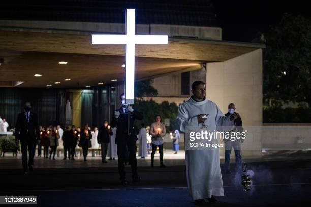Christians take part during the candle procession. Prayers of the rosary at the Chapel of the Apparitions in Cova da Iria and candle procession at...