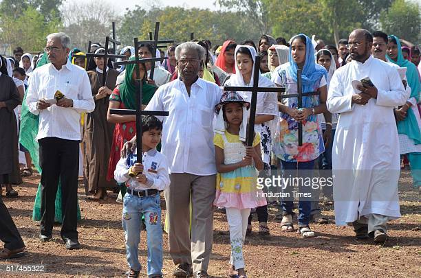 Christians take part in the Way of the Cross procession and prayer sessions organised by the SyroMalabar Church to observe Good Friday on March 25...