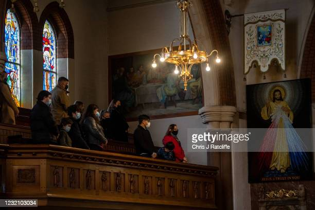 Christians wear masks and sit apart socially distanced during an Easter Sunday service at Christ the King church on April 4, 2021 in the Balham area...