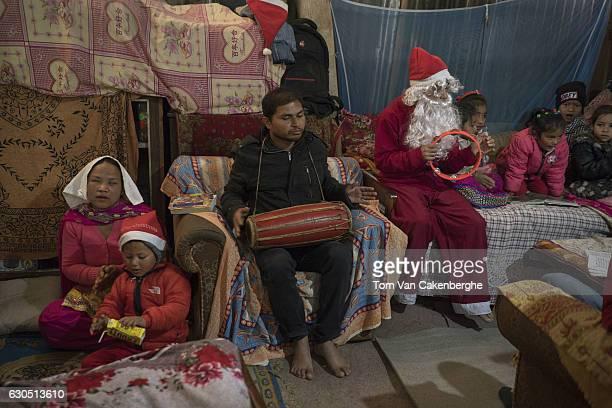 Christians wearing Santa costumes celebrate Christmas in a slum area on December 25 2016 in Kathmandu Nepal Many Christians in Nepal celebrate...