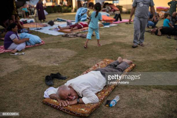 Christians who fled fighters with the Islamic State from villages surrounding Mosul sleep in a church in Erbil in Northern Iraq August 15 2014 Since...
