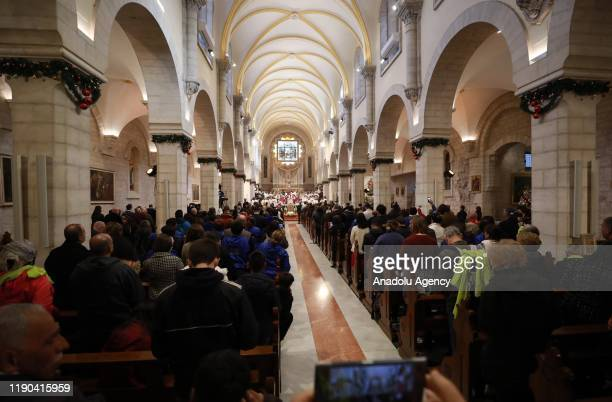 Christianss attend the Christmas mass at the Church of St Catherine to lead the ritual to mark Christmas in Bethlehem West Bank on December 24 2019