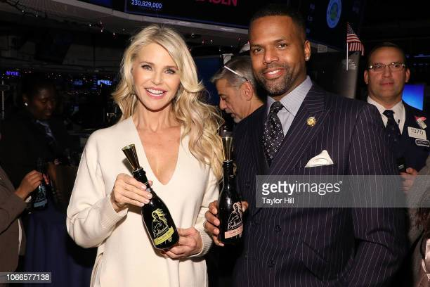 Christie Brinkley and AJ Calloway pose together at New York Stock Exchange on November 29 2018 in New York City