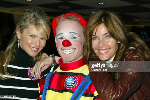 Christie Brinkley and Carol Alt pose with a circus clown