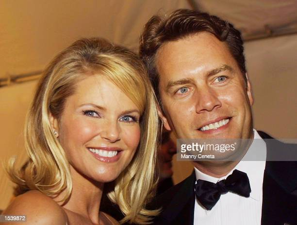 Christie Brinkley and husband Peter Cook arrive at the Bloomberg party following the annual White House Correspondents'' dinner May 4 2002 in...