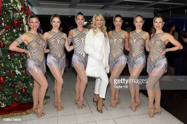 Christie Brinkley and the Rockettes pose together at New York Stock Exchange on November 29 2018 in New York City