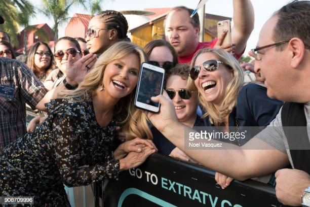 Christie Brinkley poses with fans at 'Extra' at Universal Studios Hollywood on January 18 2018 in Universal City California
