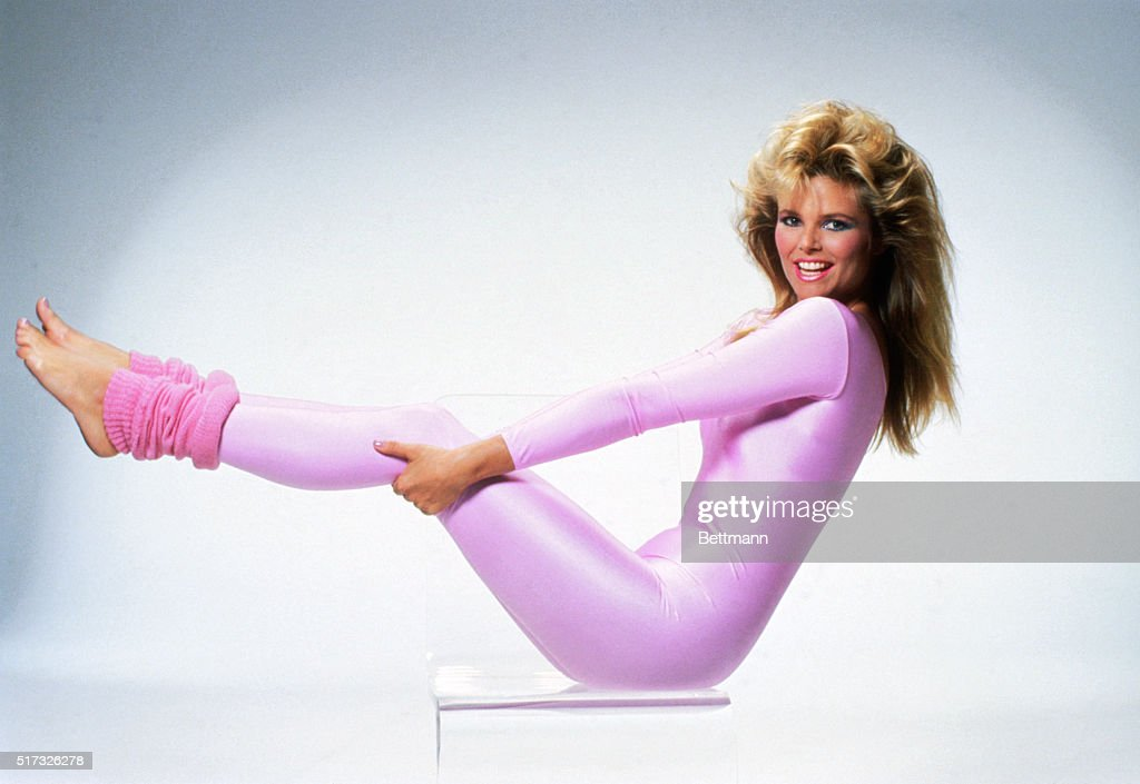 Christie Brinkley works out in a pink spandex unitard and leg warmers.