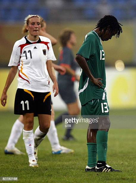 Christie George captain of Nigeria's women Olympic football team shows her dejection after losing 10 to Germany in a Group F match at the 2008...
