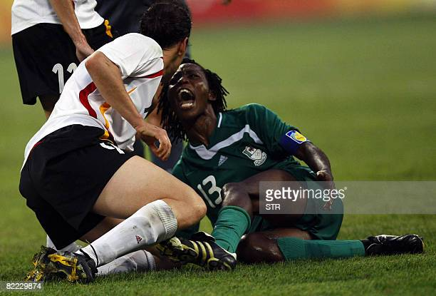 Christie George of Nigeria argues with Birgit Prinz of Germany during the 2008 Beijing Olympic Games women's first round Group F football match at...