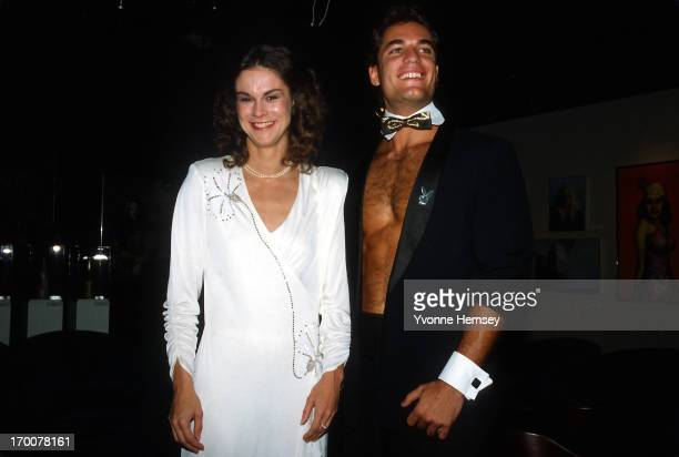 Christie Hefner and a male bunny are photographed October 29, 1985 at the re-opening of the Playboy club in New York City.