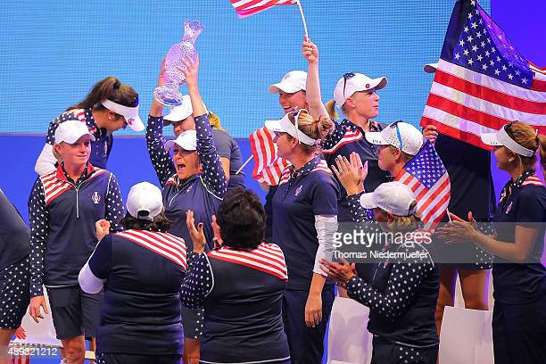 Christie Kerr of the Unitedt States Team shows the trophy during the closing ceremony at the 2015 Solheim Cup at St LeonRot Golf Club on September 20...