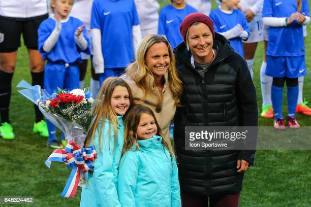 Christie Rampone has her National Team jersey retired along with her daughters and former teammate Abby Wambach on the field prior to the SheBelieves...