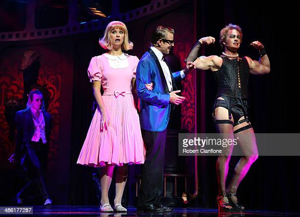Christie Whelan Browne as Janet Tim Maddren as Brad and Craig McLachlan as Frank N Furter perform during a media call for the Rocky Horror Show at...