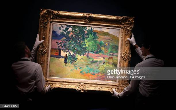 Christie's art handlers hang Te Fare by Paul Gauguin estimated to fetch pound1218000 which is part of their Impressionist and Modern art and the Art...
