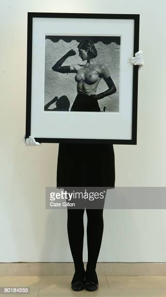 Christies' assistant holds the photograph 'Tied up Torso Ramatuelle 1980' by Helmut Newton on March 10 2008 in London England The Collection is owned...