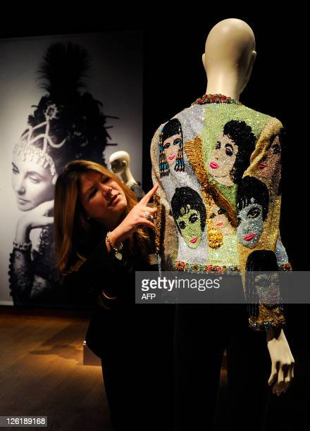 A Christie's auction house employee poses for photographers in London on September 23 with a jacket called The Face that belonged to actress...