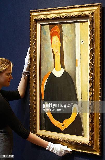"Christie's auction house porter adjusts Italian painter Amedeo Modigliani's ""Portrait de Jeanne Hebuterne"", estimated value 5-7 million pounds in..."