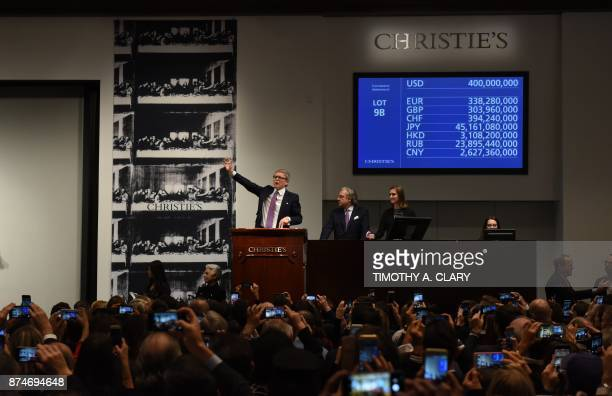 Christie's auctioneer Jussi Pylkkanen signals the final auction bid for Leonardo da Vincis 'Salvator Mundi' at Christie's New York on November 15...