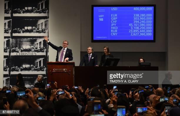Christie's auctioneer Jussi Pylkkanen signals the final auction bid for Leonardo da Vincis 'Salvator Mundi' at Christie's New York on November 15...