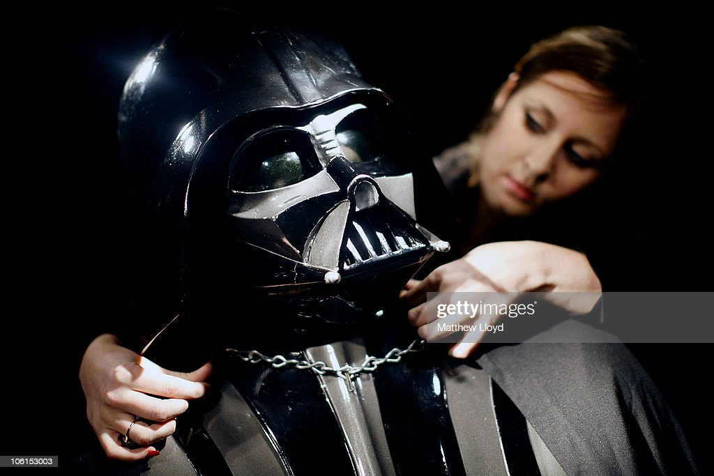 Christie's employee Caitlin Graham with an original Darth Vader costume from the Star Wars films on display in Christie's auction house on October 27, 2010 in London, England. The rare collectors piece is expected to realise between GBP160,000 and GBP230,000.