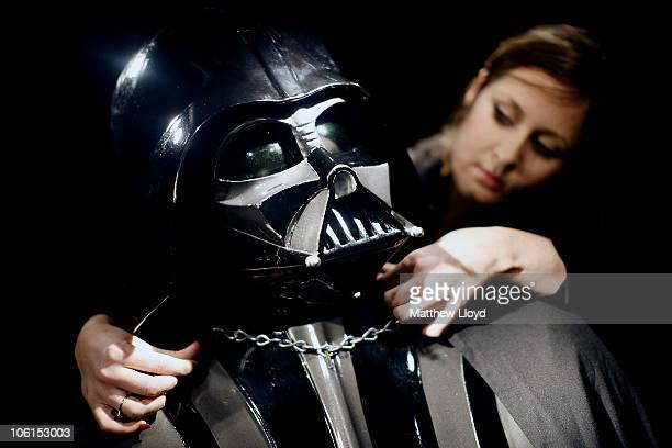 Christie's employee Caitlin Graham with an original Darth Vader costume from the Star Wars films on display in Christie's auction house on October 27...
