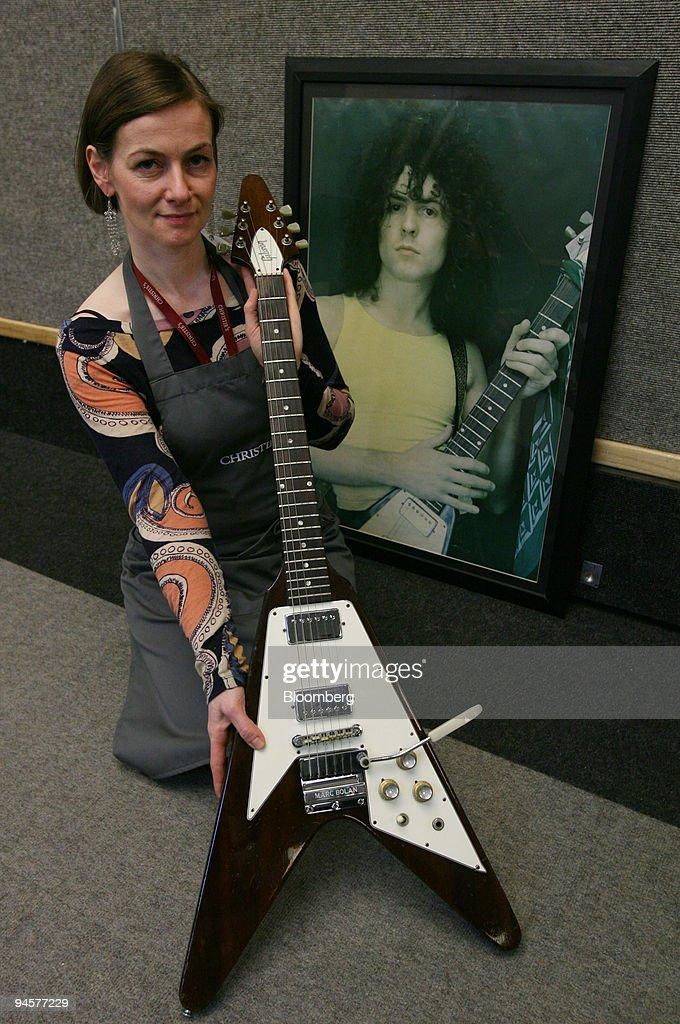 A Christies employee displays a 1968 Gibson Flying V