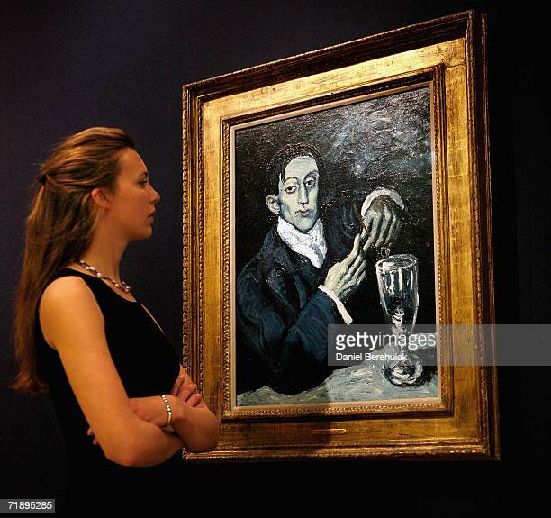 Christie's employee Emma Dodson observes the Portrait of Angel Fernandez de Soto painted by Picasso at Christie's Auction House on September 15 2006...