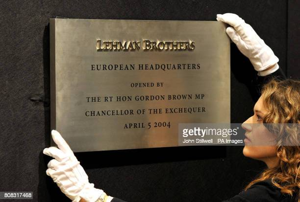 Christie's employee Eryn Brobyn adjusts artwork from the Lehman Brothers sale during a photo call at Christie's in west London before they goes under...