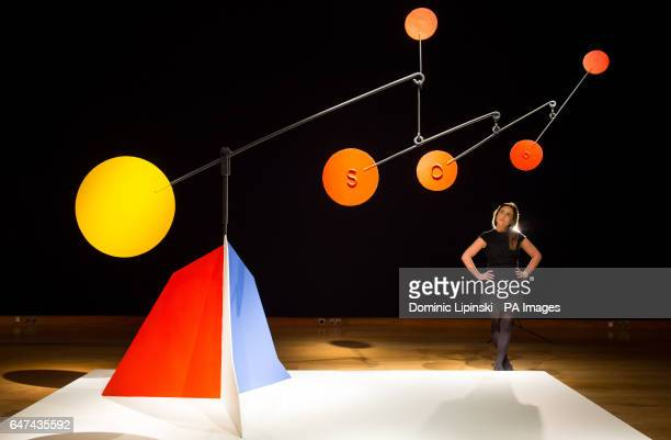 A Christie's employee looks at Untitled by Alexander Calder which is expected to fetch Acircpound3000Acircpound5000 during their PostWar and...