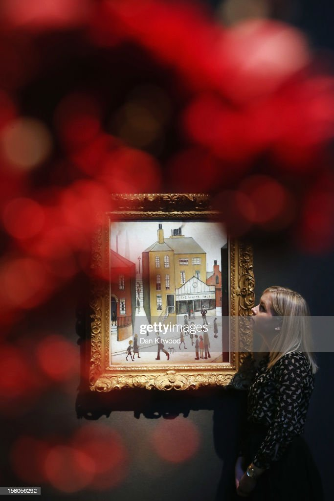 A Christie's employee stands next to a painting entitled 'The White Shop,' by Laurence Stephen Lowry during a press call at Christie's auction house on December 10, 2012 in London, England. The painting makes up part of the 'Rule Britannia' modern British art evening sale and is expected to fetch between £700,000 and £1M GBP when it goes on sale on December 12, 2012. The sale also includes pieces from restauranteur and art collector Peter Langan, whose Langan's 'Brasserie' and 'Odin's' will sell some of their collection which includes works by David Hockney.